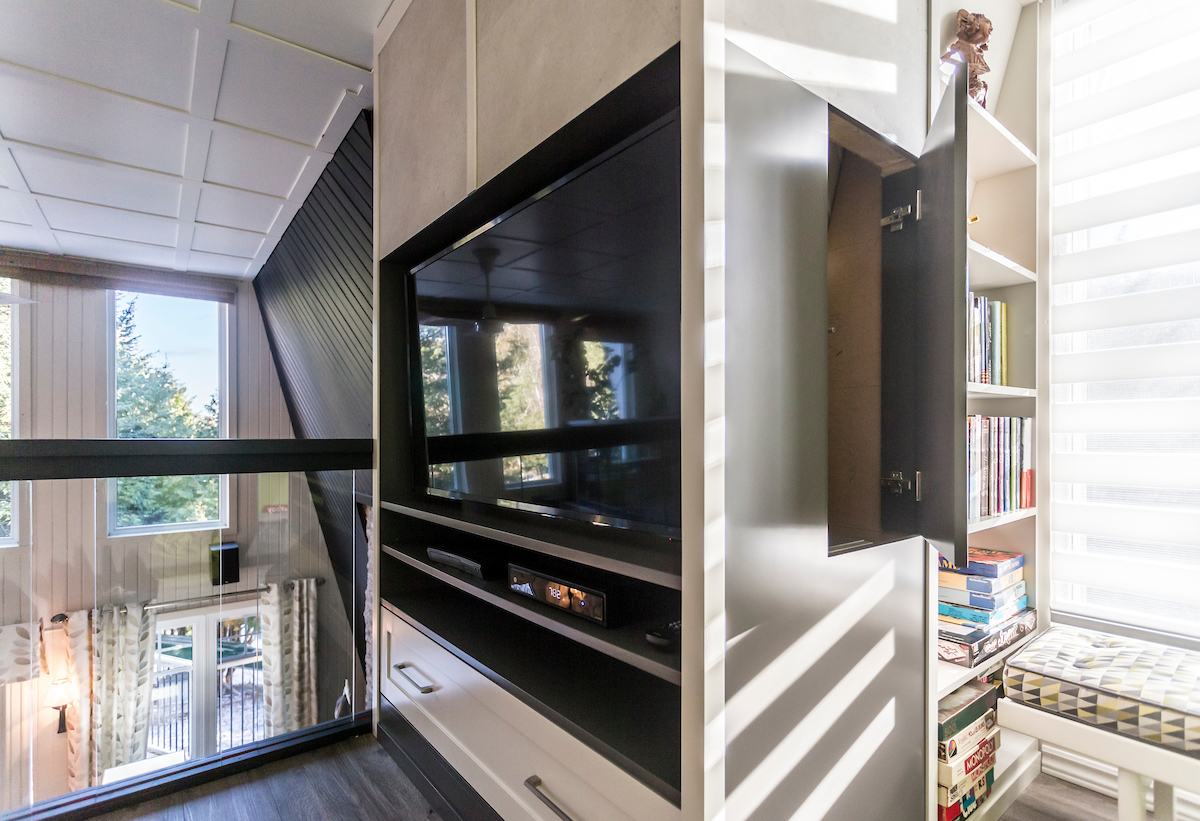 Built in furniture under a sloping wall bookcase tv stand